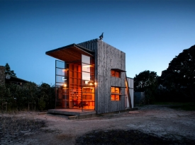 Hut-on-Sleds-in-Evening-with-Shutter-Up-to-Form-Awning-and-Two-Story-Doors-Open-1024x682