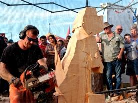 Chainsaw Sculptor Creates Wooden Dog Sculpture